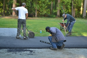 crew measuring the driveways slope